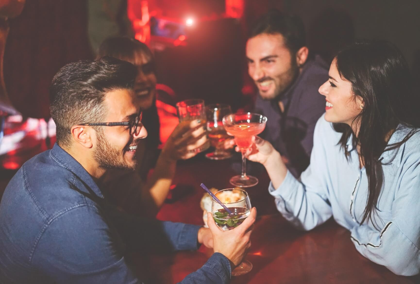 Photo with people enjoying their drinks in a club